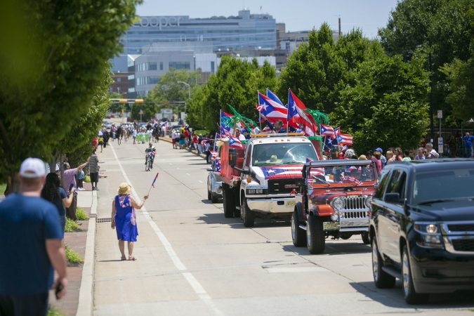Thousands gather in Camden to celebrate the San Juan Bautista Parade and Festival. (Miguel Martinez/WHYY)