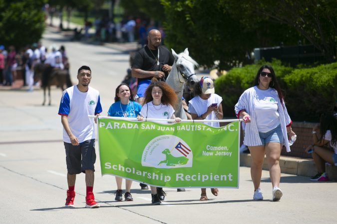 During the San Juan Bautista Parade, four high school students from Camden were awarded scholarships to continue their education in college. (Miguel Martinez/WHYY)