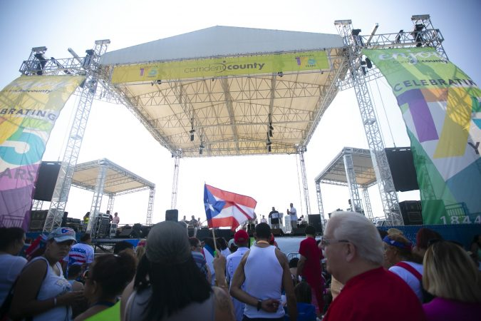 Thousands gather at the Camden's waterfront to celebrate the San Juan Bautista Parade and Festival. The parade has been a tradition in the city for the past 62 years. (Miguel Martinez/WHYY)