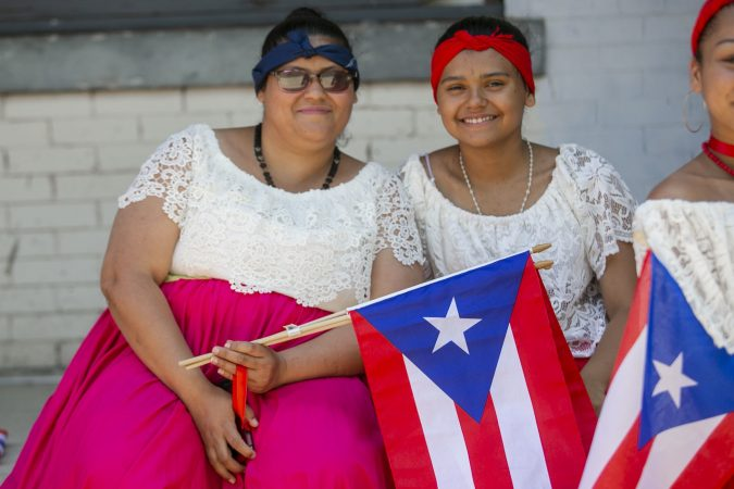 Karinairy Delgado and her mother Ivira Santiago attend the San Juan Bautista Parade and Festival. (Miguel Martinez/WHYY)