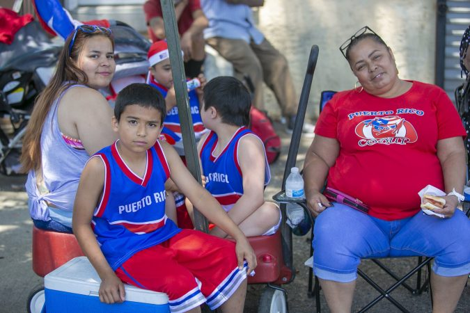The Rodriguez family from Camden attend the San Juan Bautista Parade and Festival.  (Miguel Martinez/WHYY)