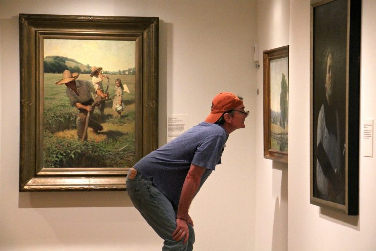 A visitor to the Brandywine River Museum takes a closer look at
