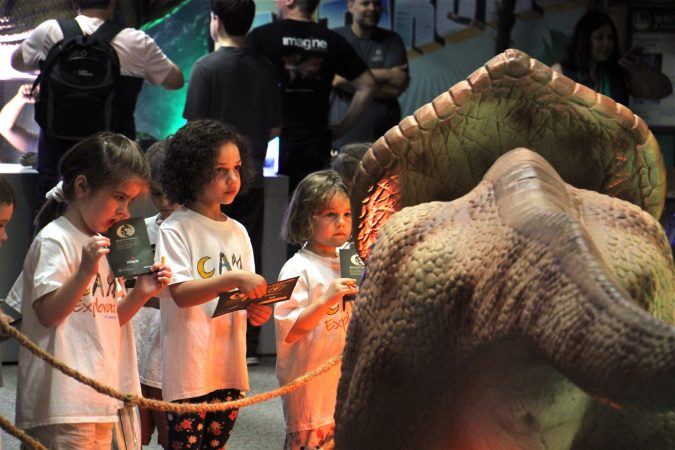 Children from Bright Horizons daycare at St. Mary Medical Center study an animatronic  protoceratops at the Academy of Natural Sciences. (Emma Lee