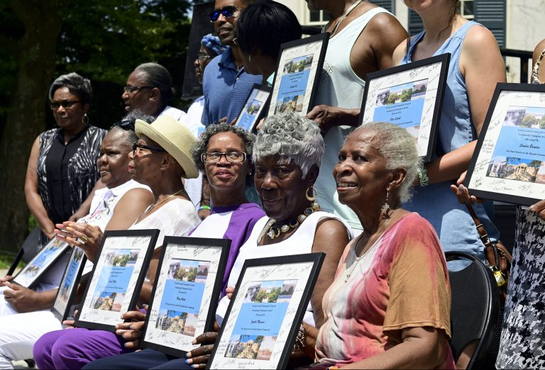 Award recipients pose for pictures after a ceremony at the inaugural Unity Day at Vernon Park, in Germantown, on Saturday. (Bastiaan Slabbers for WHYY)