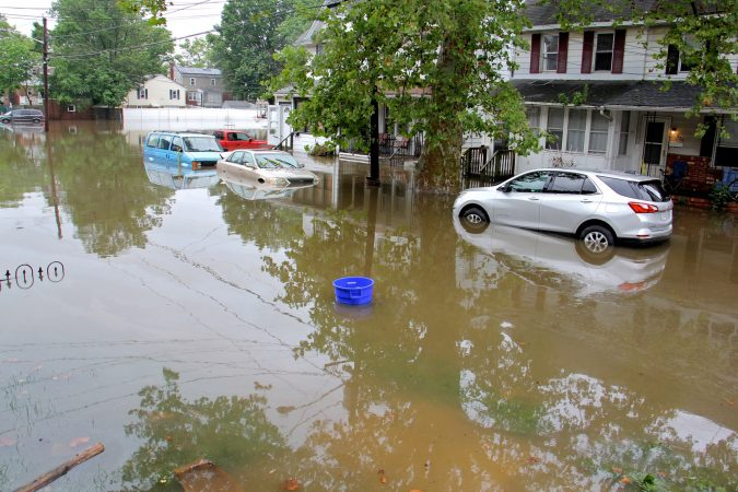 Cars, homes and streets were swamped by heavy rains overnight in Westville, N.J. (Emma Lee/WHYY)