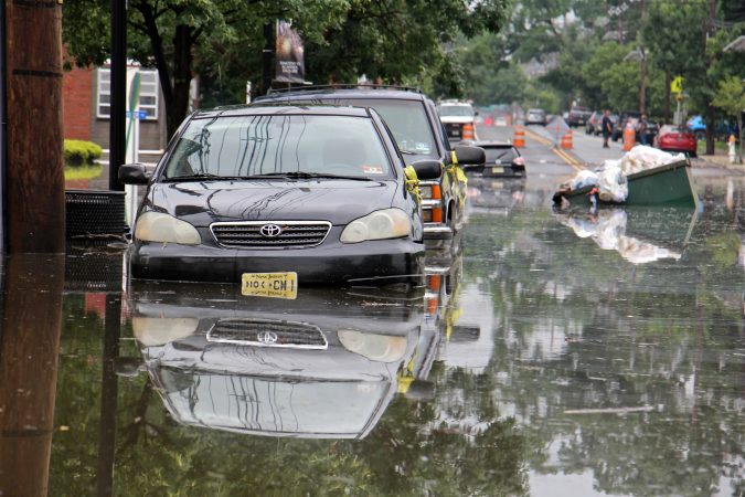Cars, homes and streets in low lying areas of Westville, N.J. were swamped by heavy rains overnight. (Emma Lee/WHYY)