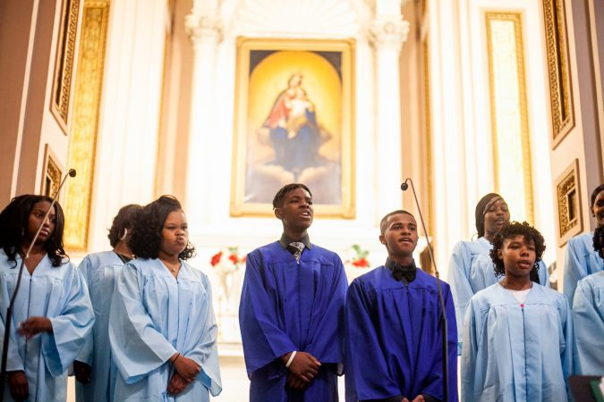 Graduating students of the Gesu School sing hymns during the schools graduation ceremony earlier this month. (Brad Larrison for WHYY)