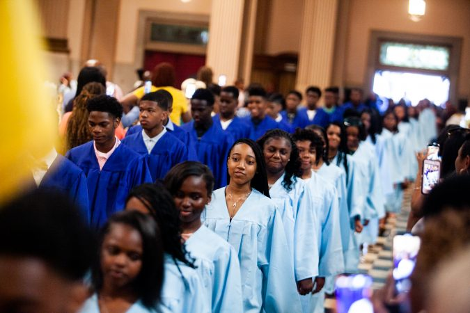 Students walk in lockstep inside the Church of the Gesu before the school's graduation ceremony earlier this month. (Brad Larrison for WHYY)