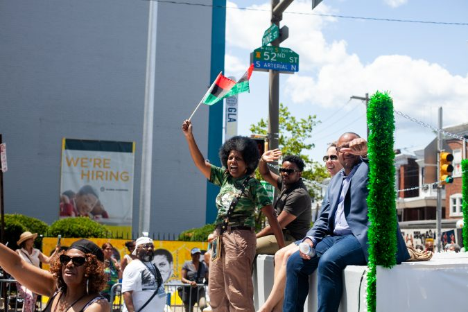 The Juneteenth Parade makes its way down 52nd Street in West Philadelphia in June 2019 where it was being held for the first year after moving from Center City. (Brad Larrison for WHYY)