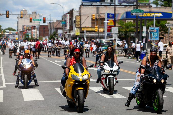 The Juneteenth Parade makes its way down 52nd Street in West Philadelphia Saturday where it was being held for the first year after moving from Center City Philadelphia. (Brad Larrison for WHYY)