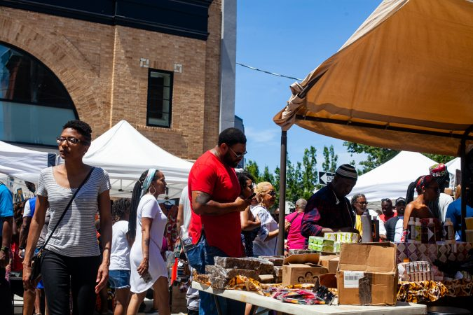 Festival goers shopped for goods during the annual Odunde Festival Sunday afternoon. (Brad Larrison for WHYY)