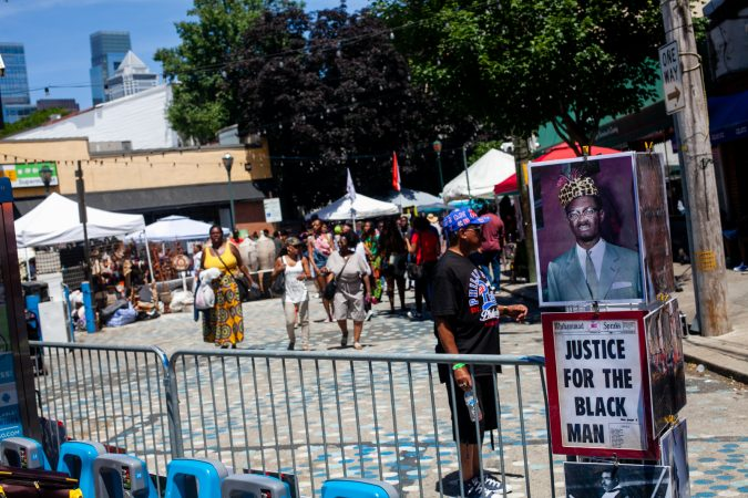 Posters for sale were on display at the annual Odunde Festival Sunday afternoon. (Brad Larrison for WHYY)