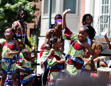 African heritage dancers perform at the Odunde Festival Sunday. (Brad Larrison for WHYY)