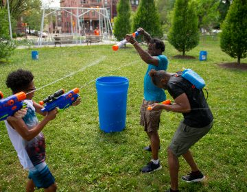 Families from across Philadelphia came to Fairmount Park to participate in the Water Fight Philly event on Sunday, June 30, 2019. (Kriston Jae Bethel for WHYY)