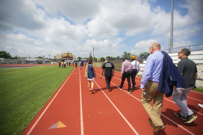 A group tours the Camden High School athletic facilities on Thursday, June 6, 2019 (Miguel Martinez for WHYY)