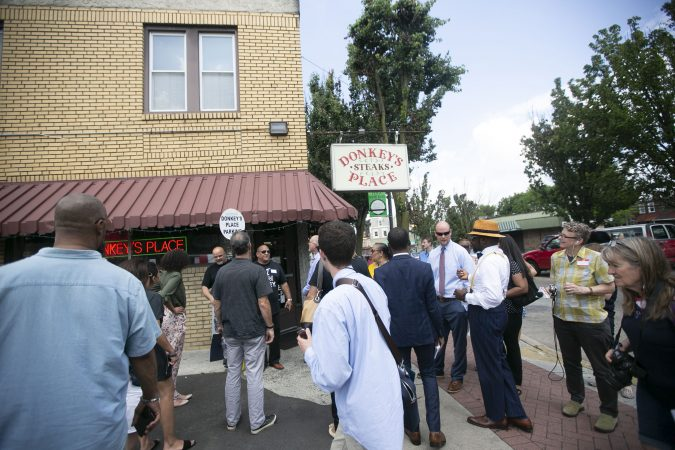 A group of activists gather for a tour of Camden to show the inequality in the city even after new businesses moved in (Miguel Martinez for WHYY)