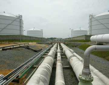 Pipelines run from the offshore docking station to the four LNG tanks capable of holding 2.5 billion cubic feet of LNG apiece as shown Friday, June 13, 2003, at the Dominion Liquified Natural Gas facility in Cove Point, Md. (Matt Houston/AP Photo)