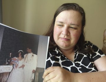 "Heidi Clark holds a photograph from her 1995 wedding at her home in Orem, Utah, on Friday, May 18, 2018. Clark became pregnant at 16 and married soon after, under pressure from her boyfriend's religious community of Seventh-Day Adventists in Pennsylvania, she said. ""I always felt a little bit like I was trapped,"" Clark said, now 40. ""I was 17. I was so young."" (Rick Bowmer/AP Photo)"
