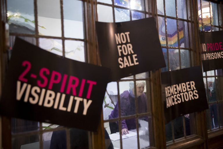 In this Wednesday, March 27, 2019, photo, a participant checks in as she arrives for a meeting of the Reclaim Pride Coalition at the Church of the Village in New York. Activists who believe New York City's annual LGBTQ Pride march has become too commercialized are staging an alternative march the same day. The two marches through Manhattan streets will take place Sunday, June 30, the last day of a month of celebrations marking the 50th anniversary of the 1969 Stonewall uprising. (Mary Altaffer/AP Photo)