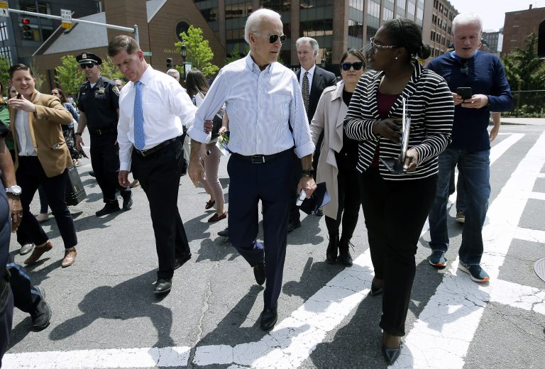 Former vice president and Democratic presidential candidate Joe Biden speaks with a woman as he walks with Boston Mayor Marty Walsh, left, on Wednesday, June 5, 2019, in downtown Boston. (Steven Senne/AP Photo)