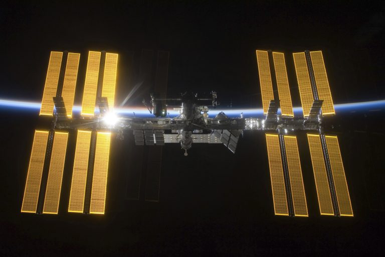 This March 25, 2009 photo provided by NASA shows the International Space Station seen from the Space Shuttle Discovery during separation.  NASA announced Friday, June 7, 2019 that it will open the International Space Station to private astronauts, with the first visit as early as next year. (NASA via AP)