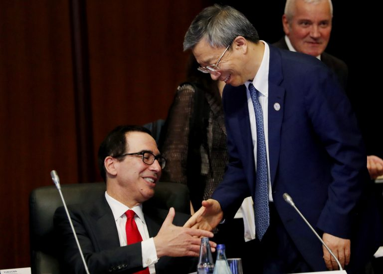 China's Central Bank Governor Yi Gang shakes hands with U.S. Treasury Secretary Steve Mnuchin, (left), during the G20 Finance Ministers and Central Bank Governors Meeting Saturday, June 8, 2019, In Fukuoka, Japan. (Kim Kyung-hoon/Pool Photo via AP)