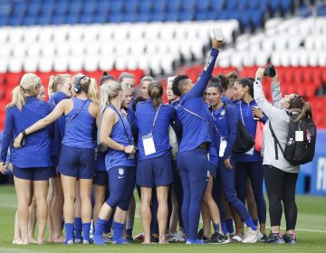 United States' players take photos during a visit at the Parc des Princes stadium a day before the Group F soccer match between United States and Chile at the Women's World Cup in Paris, Saturday, June 15, 2019. (AP Photo/Alessandra Tarantino)