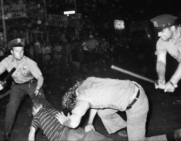 FILE - In this Aug. 31, 1970 file photo, an NYPD officer grabs a youth by the hair as another officer clubs a young man during a confrontation in Greenwich Village after a Gay Power march in New York. A year earlier, the June 1969 uprising by young gays, lesbians and transgender people in New York City, clashing with police near a bar called the Stonewall Inn, was a vital catalyst in expanding LGBT activism nationwide and abroad. (AP Photo/File)