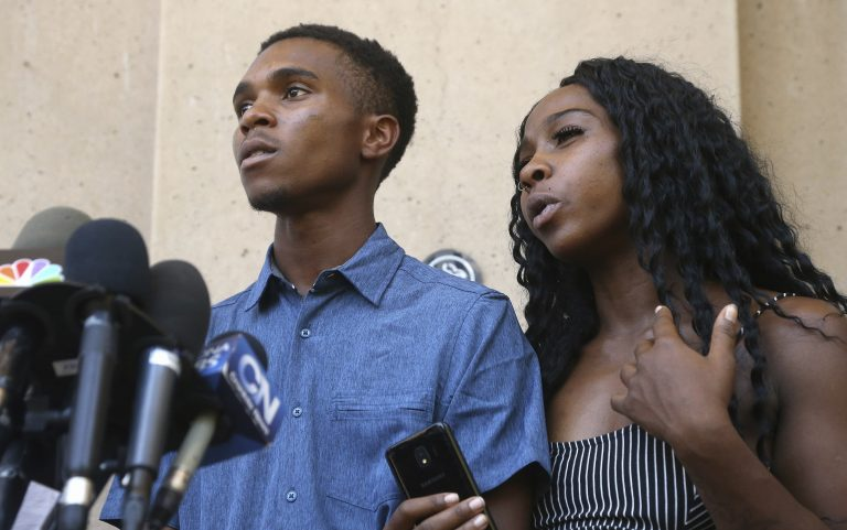 Iesha Harper, (right), answers a question during a news conference as she is joined by her fiancee Dravon Ames, (left), at Phoenix City Hall, Monday, June 17, 2019, in Phoenix. Ames and his pregnant fiancée, Harper, who had guns aimed at them by Phoenix police during a response to a shoplifting report, say they don't accept the apologies of the city's police chief and mayor and want the officers involved to be fired. (Ross D. Franklin/AP Photo)