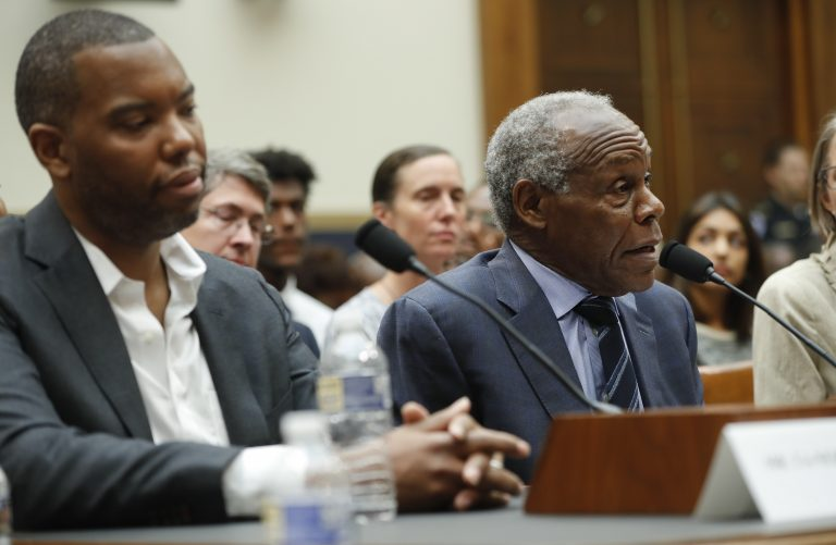 Actor Danny Glover, right, and author Ta-Nehisi Coates, left, testify about reparation for the descendants of slaves during a hearing before the House Judiciary Subcommittee on the Constitution, Civil Rights and Civil Liberties, at the Capitol in Washington, Wednesday, June 19, 2019. (Pablo Martinez Monsivais/AP Photo)