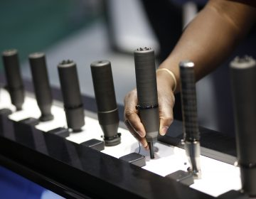 In this Jan. 19, 2016 file photo, gun silencers are on display at the Sig Sauer booth at the Shooting, Hunting and Outdoor Trade Show in Las Vegas. Gun silencers like the one used in a recent lethal shooting in Virginia Beach would be banned under legislation that U.S. Sen. Bob Menendez of New Jersey introduced Friday, June 21, 2019. (John Locher/AP Photo, File)