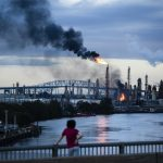 Flames and smoke emerge from the Philadelphia Energy Solutions Refining Complex in Philadelphia, Friday, June 21, 2019. Explosions and a blaze at the largest oil refinery on the East Coast shook homes before dawn Friday, though authorities reported only a few minor injuries and said the air was safe to breathe. (Matt Rourke/AP Photo)