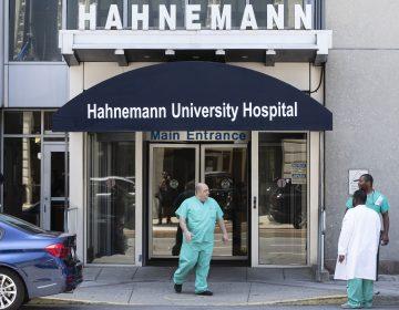A person exits Hahnemann University Hospital in Philadelphia, Wednesday, June 26, 2019.  (AP Photo/Matt Rourke)