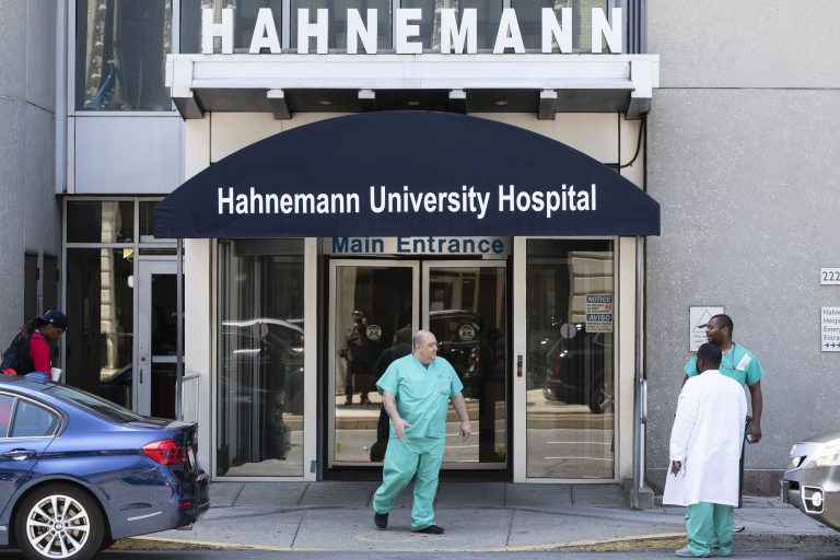 A person exits Hahnemann University Hospital in Philadelphia, Wednesday, June 26, 2019.  (AP Photo/Matt Rourke)
