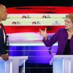 Democratic presidential candidate Sen. Elizabeth Warren, D-Mass., gestures towards New Jersey Sen. Cory Booker, during a Democratic primary debate hosted by NBC News at the Adrienne Arsht Center for the Performing Arts, Wednesday, June 26, 2019, in Miami. (Wilfredo Lee/AP Photo)