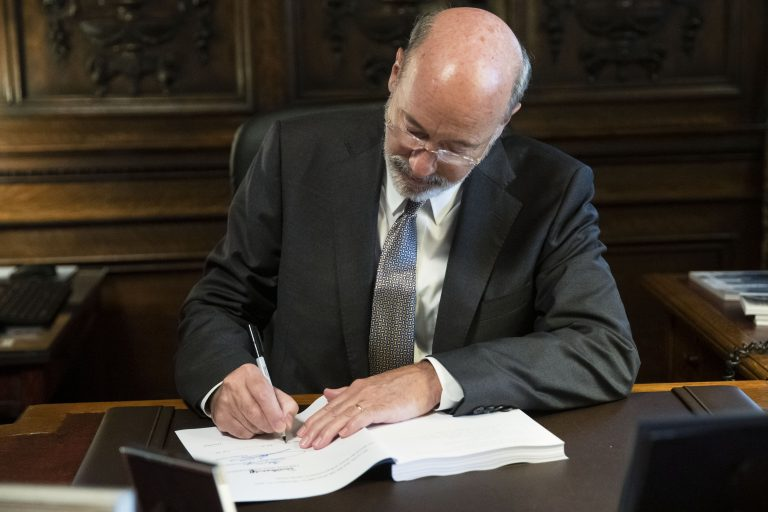 Pennsylvania Gov. Tom Wolf signs the main appropriations bill in a $34 billion budget package that passed the Legislature this week at the state Capitol in Harrisburg, Pa., Friday, June 28, 2019. (Matt Rourke/AP Photo)