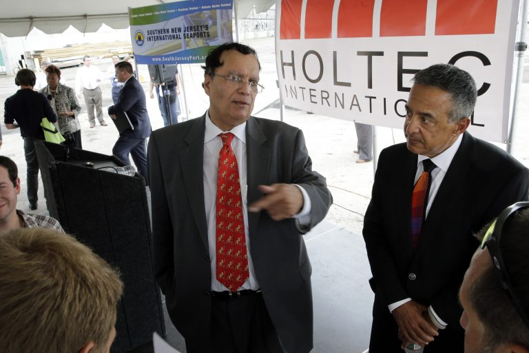 Kris Singh, center, the founder, president and CEO of Holtec International. The company was granted the second-largest tax break in state history, but officials placed a hold on the break following our reporting. (Mel Evans/AP Photo)