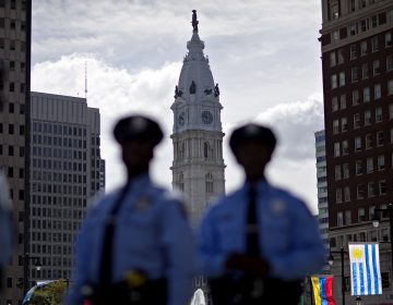 Police stand along Benjamin Franklin Parkway as City Hall stands in the background, Friday, Sept. 25, 2015, in Philadelphia. (AP Photo/David Goldman)