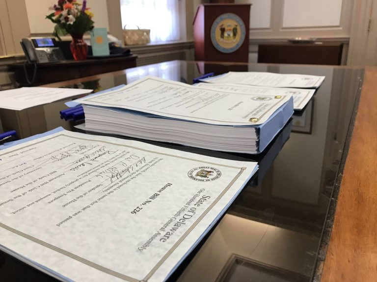 Gov. John Carney signed Delaware's $4.45 billion budget Tuesday afternoon in his Dover office. (Courtesy of Carney staff)