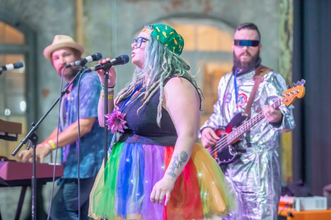 Liz Cisco who fronts the Trenton-based band MegaNow performs for an audience. (Jonathan Wilson for WHYY)