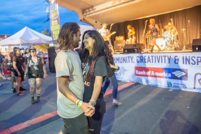 Josh Farber and Molli Byrn dance to the band Molly Rhythm. (Jonathan Wilson for WHYY)