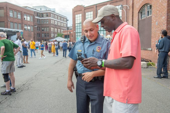 Army Sergeant Cedrick Ghant-David struck up a conversation with Trenton Police detective Sammy Gonzalez. Gonzalez was one or the detectives who processed the shooting scene at last year's Art All Night event. (Jonathan Wilson for WHYY)