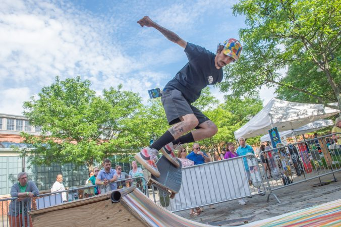 Rich Whitehead takes his turn on a ramp set up by Freedom NJ, a non-profit that creates pop-up skateboard parks for kids in New Jersey and the surrounding states. (Jonathan Wilson for WHYY)