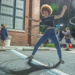 Gianni Jones takes her turn with the hula hoops, which were one of the Art All Night attractions. (Jonathan Wilson for WHYY)