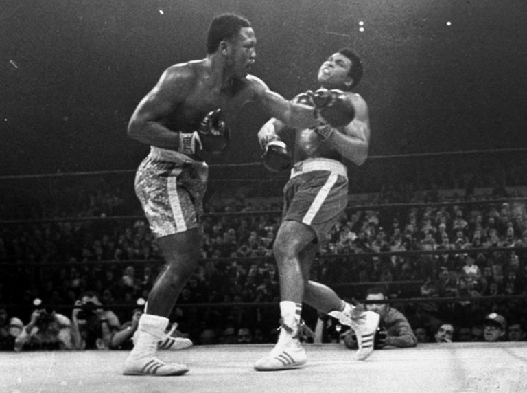 Joe Frazier hits Muhammad Ali with a left during the 15th round of their heavyweight title fight at New York's Madison Square garden in this March 8, 1971 photo. (AP Photo/stf)