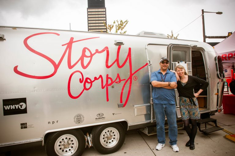 WHYY engineer, Al Banks, left, and WHYY's Morning Edition host, Jennifer Lynn, pose outside the StoryCorps MobileBooth which is parked this month at The Porch at 30th Street Station.  (Laurie Beck Peterson)