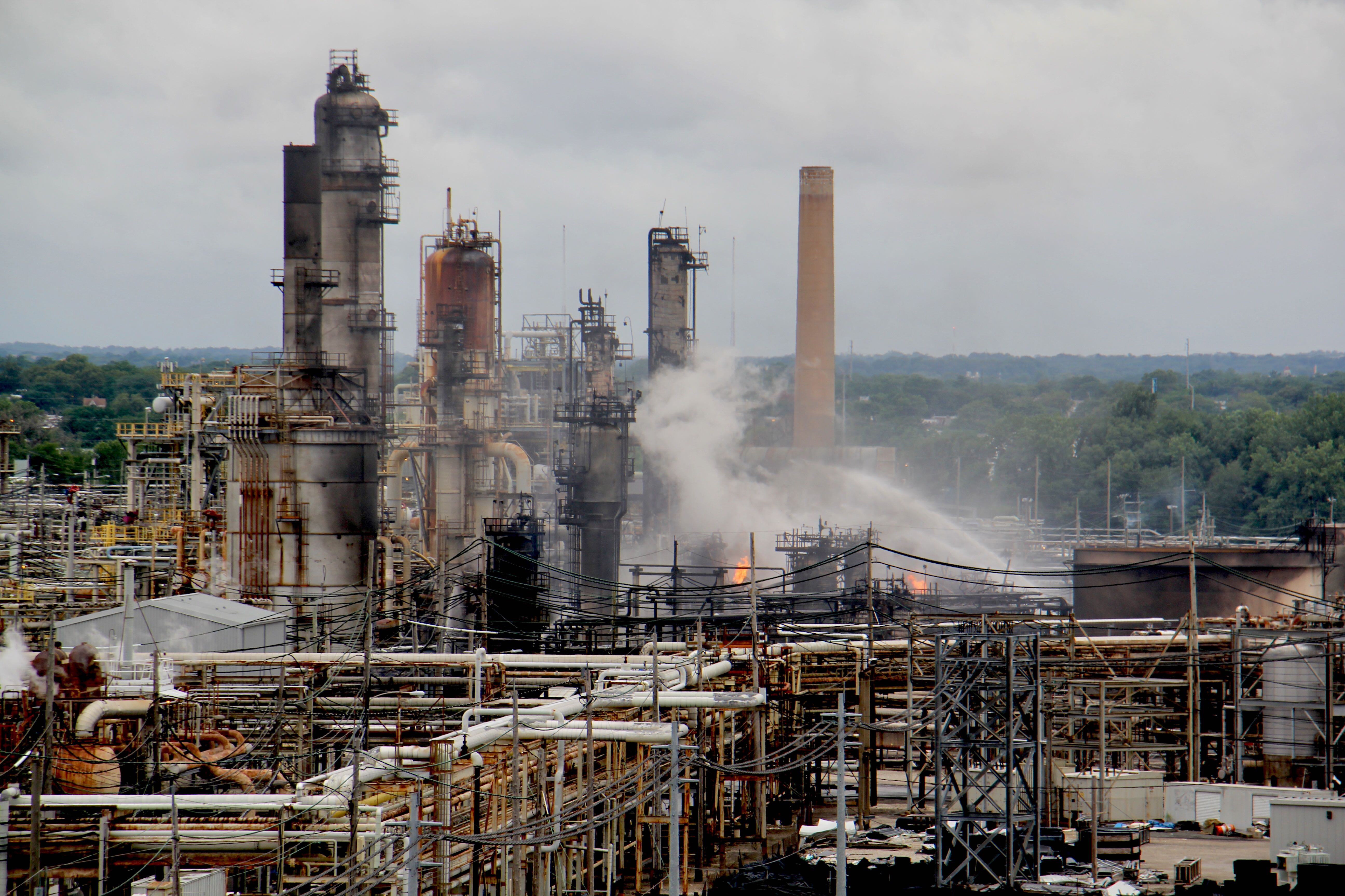 9995d14e1ae Fire fighters continue to battle flames at the PES refinery. (Emma Lee/WHYY)