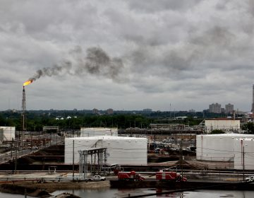 Winds carry a cloud of black smoke from a flare at PES refinery. (Emma Lee/WHYY)