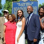 "Savannah Shepherd (center) poses with members of the Delaware Legislative Black Caucus in front of The Lynching of George White Historical Marker after it was unveiled at Greenbank Park on June 23. Pictured are (from left) Rep. Melissa Minor-Brown, Rep. Frank Cooke, Rep. Stephanie T. Bolden, Shepherd, Sen. Darius Brown, Rep. Kendra Johnson, and Sen. Elizabeth ""Tizzy"" Lockman (Scott Goss/Delaware Senate Majority Caucus)"