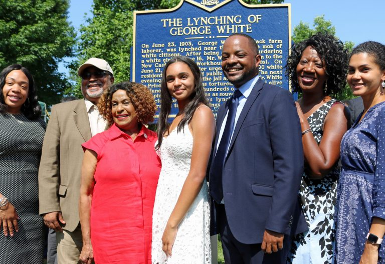 """Savannah Shepherd (center) poses with members of the Delaware Legislative Black Caucus in front of The Lynching of George White Historical Marker after it was unveiled at Greenbank Park on June 23. Pictured are (from left) Rep. Melissa Minor-Brown, Rep. Frank Cooke, Rep. Stephanie T. Bolden, Shepherd, Sen. Darius Brown, Rep. Kendra Johnson, and Sen. Elizabeth """"Tizzy"""" Lockman (Scott Goss/Delaware Senate Majority Caucus)"""